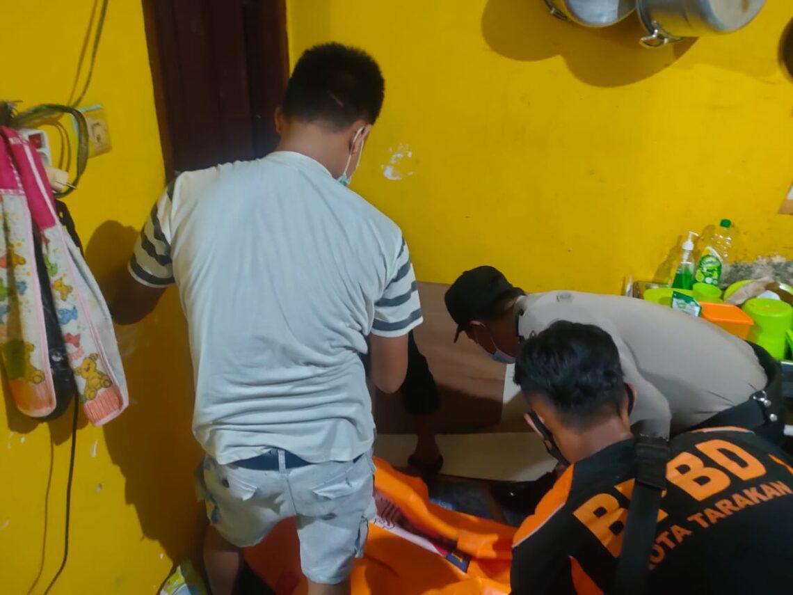 Aparat keamanan dan warga serta petugas BPBD Kota Tarakan mengevakuasi korban. (foto: istimewa)